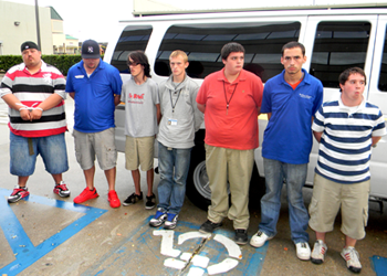 The seven defendants in the Lebeau Mansion arson fire of Nov. 22, 2013 – shown about to enter a jail van after their arrests that day – have all pleaded guilty and been sentenced. Shown from left are Bryon Meek, Dusten Davenport, Kevin Barbe, Joshua Allen, Jerry Hamblen, Joseph Landin and Joshua Brisco.