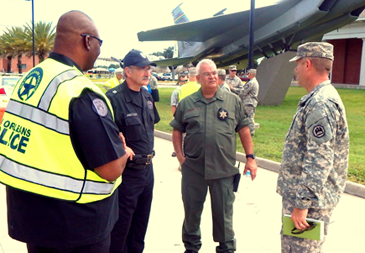 From left, New Orleans Police Sgt. Sherman Joseph, Capt. Jimmy Scott, head of the NOPD SWAT team; St. Bernard Sheriff;'s Office Maj. Mark Poche, head of the Special Operations Division; and Lt. Col. Kenneth Copple, deputy base commander, discuss the active shooter drill at Jackson Barracks.
