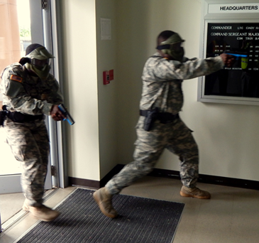 National Guardsmen enter a building at the Jackson Barracks base as part of a simulated active shooter situation on Aug. 27.