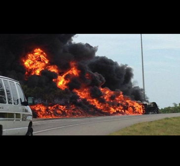 An overturned tanker truck on fire on Interstate-10 in eastern New Orleans on Aug. 26 after its driver was rescued.