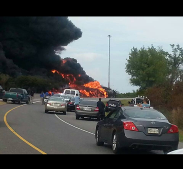 Vehicles are backed up on the interstate by the fiery accident.