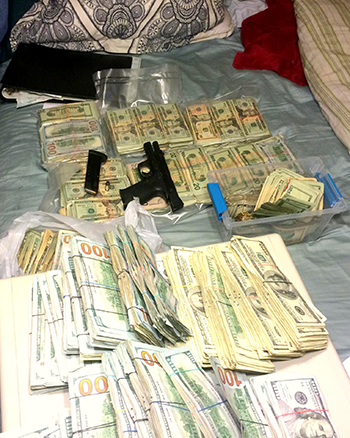 Some $425,000 in drug cash and a gun seized in a a multi-agency effort including the St. Bernard Parish Sheriff's Office Special Investigation Division.