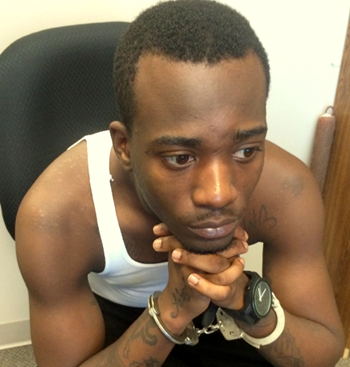 Shiquille Robinson, 21, handcuffed in the sheriff's Criminal Investigations Bureau before being booked with carjacking.