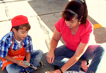 Alex Ricouard, holding a hammer, and Elyce Ricouard of Chalmette, make something together during the Home Depot kids workshop and safety event on Saturday Oct. 4, which drew a large number of parents and children to an event which featured equipment on display from the Sheriff's Office, the Fire Department and Acadian Ambulance.