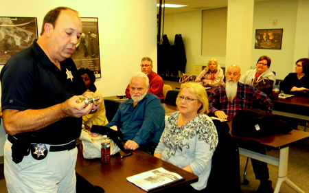 Capt. Charles Borchers demonstrates items to the class at the 2013 lecture for the Refuse to be a Victim course being held again on Dec. 10.