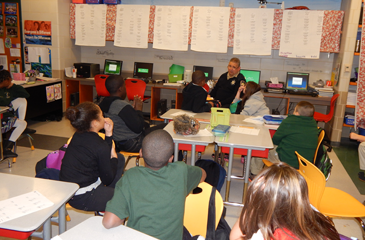 Dep. Eric Eilers reads to students in the classroom of teacher Emilie Snyder.