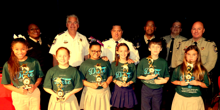 Lacoste Elementary, D.A.R.E. essay winners in front row are Brianne Torres, Austin Cone, Alexys Ford, Emily Gonzalez, Hailey Lobre and Dalilah McKinnies. In back are Lt. Lisa Jackson, Sheriff James Pohlmann, Maj. Chad Clark, Lt. Richard Jacksom, Sgt. Darrin Miller and Capt. Ronnie Martin.
