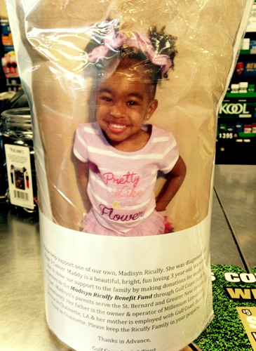 The canister, with a photo of the girl the money was being collected for, Madisyn Riculfy, 3, of Chalmette.