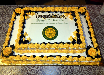 The cake on display for  the reception in the lobby of the Courthouse.