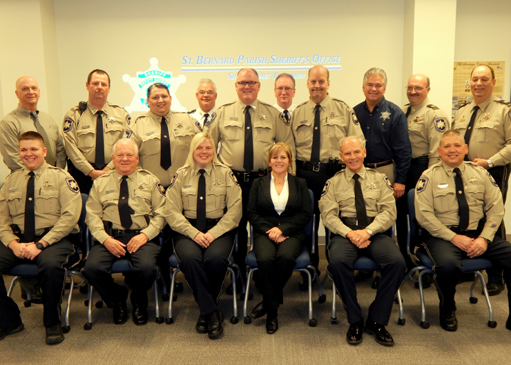 Eight men and two women in the Sheriff's Office Reserve Division graduated an 80-hour course in basic law enforcement on Jan. 15. Shown at the graduation are, seated from left, Reserve Division members Harold Larter, Dennis Trocchiano, Tanya Palazzalo, Melissa Wickboldt and Michael Bendich and Dep. Eric Eillers of the Community Relations Division. In back, from left, are Reserve deputies Ray Tauzier, Edward Manint and Raul Vallecillo, Maj. Mark Poche, commander of the Special Operations Division which includes Reserves; Reserve Michael Chutz, head of Training Maj. David DiMaggio, Reserve Simon Gonzales, Sheriff James Pohlmann, Reserve Capt. Joe Ricca and Capt. Charles Borchers, who heads the Reserve Division.