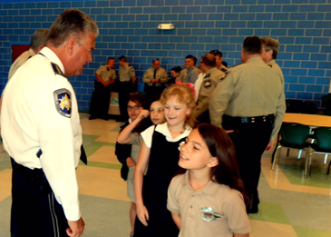 Sheriff James Pohlmann speaks with students at Arabi Elementary