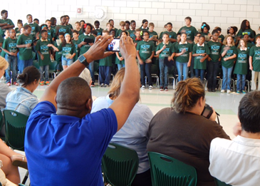 A relative of a gradduare videos students performing the D.A.R.E. theme song.