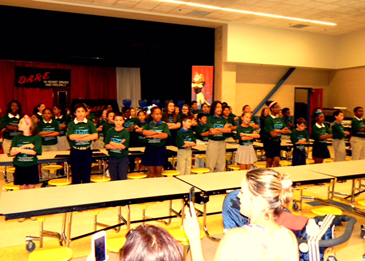 The other half of the students perform the D.A.R.E. theme song.