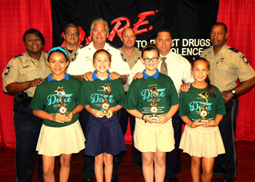 D.A.R.E. essay winners at Chalmette Elementary were, from left in front, Trinity Fortuna, Caroline Gai, Chloe Jorns and Marlene Torres. In back, from left, are D.A.R.E. instructors Lt. Lisa Jackson and Sgt. Darrin Miller, Sheriff James Pohlmann, Capt. Ronnie Martin, Maj. Chad Clark and Lt. Richard Jackson.