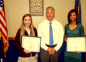 Sheriff James Pohlmann with Kelsea Glorioso, left, and Paris Blanchard-Edwards.