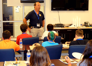Capt. Charles Borchers, coordinator of the program with Dep. Sheriff Eric Eilers, talks with the class.