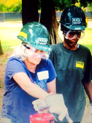 Women train by using a fire extinguisher in last year's C.E.R.T. program.