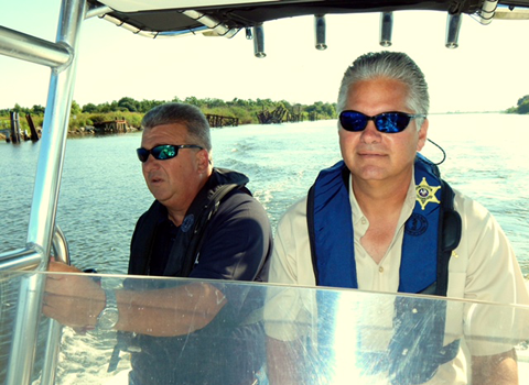 Sheriff James Pohlmann drives a department boat in preparation for summer.and hurricane season. With him is Lt. Robert Broadhead.