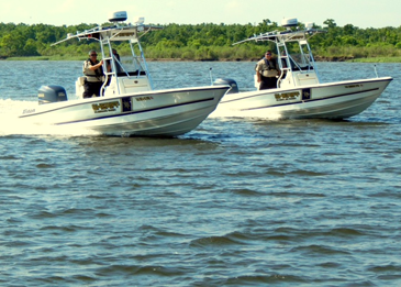 Sheriff's deputies on two department boats,