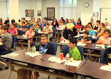More than 30 St. Bernard Parish boys and girls 10-13 gather in the Sheriff's Office Training Center to participate in the Junior Deputy Academy, with several parents sitting in at the back.