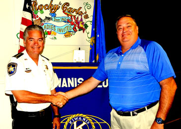 Sheriff James Pohlmann with Kiwanis Club President Mitch Perkins.