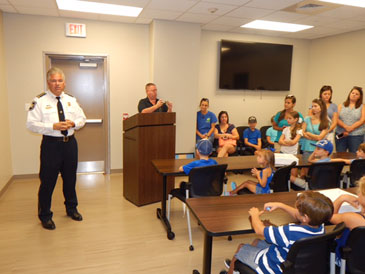 Sheriff James Pohlmann thanks the group of parents, grand-parents and children for thier support for law enforcement,