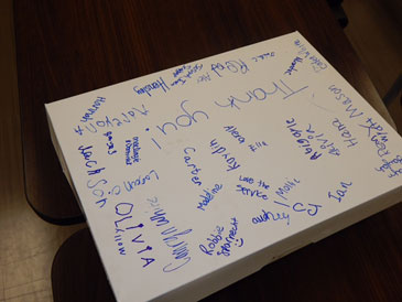 A box of doughnuts given to officers on which children signed their names.