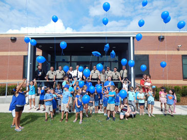 St. Bernard Parish children release balloons as part of an event to show support for law enforcement. Officers and children are standing in front of the new Sheriff's Office sub-station for Patrol Division deputies, which just opened on Paris Road.