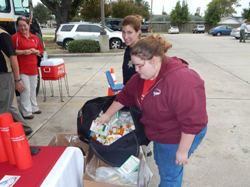 Gabrielle Eschette of Chalmette turns in a large amount of old prescription drugs at the drug take-back day at the Walgreens in Chalmette on Sept. 26. Behind her is Cpl. Jessica Gernados of the Sheriff's Office.