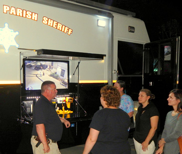 Capt. Bret Bowen discusses the department's mobile command post with class members before they go inside.