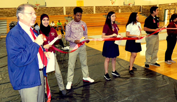 Charles Cassar, left, drug-free schools coordinator for St. Bernard's school system, discusses Red Ribbon Week and its anti-drug message as seniors from Chalmette High hold a red ribbon during a ceremony at Andrew Jackson Middle.