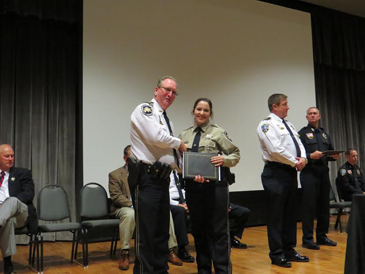 Dep. Rosalyn Cantrell receives her certificate from Maj. David DiMaggio.