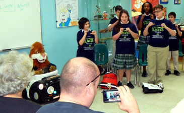 Students sing the D.A.R.E. program theme song for relatives.
