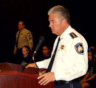 Sheriff James Pohlmann speaks to students and their relatives at Chalmette Elementary's D.A.R.E. graduation.