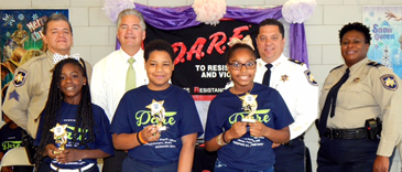 D.A.R.E. essay winners at Willie Smith Elementary were, in front from left, Sheyla Cabrera, Cameron Marquez and Shamaya Cleggett. In back are D.A.R.E. instructor Sgt. Darrin Miller, Sheriff James Pohlmann, Maj. Chad Clark and Lt. Lisa Jackson, D.A.R.E. commander.