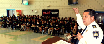 Maj. Chad Clark speaks at Arabi Elementary.