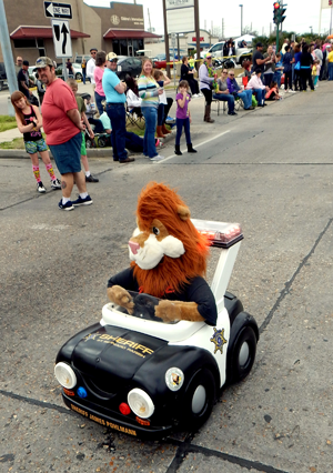 Daren the Lion, symbol of the D.A.R.E. anti-drug program taught to 5th-graders, rides in a remote controlled car.