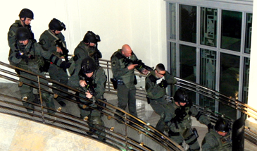 S.W.A.T. team members descend one of the iconic stairwells in the Courthouse to the lobby.