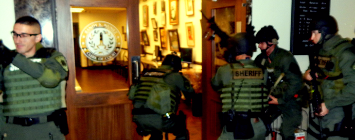 .W.A.T. members enter the Clerk's Office tp look for an armed intruder during a drill.