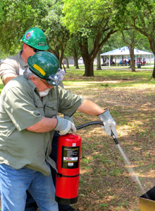 Albert Loar, foreground, and Scott Bowles use a fire extinguisher in a 2014 CERT. training session.