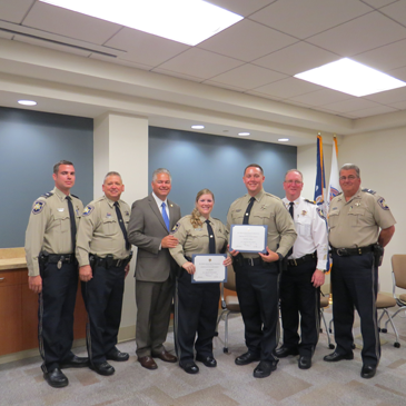 Shown from left are Lt. Dennis Morgan, Dep. Sheriff Eric Eilers, Sheriff James Pohlmann, P.O.S.T. school graduates Dep. Keri Krenkel and Matthew Schmill, Maj. David DiMaggio and Lt. Robert Broadhead.