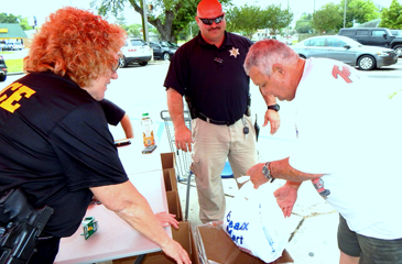 A man drops off medications at the drug take-back day.