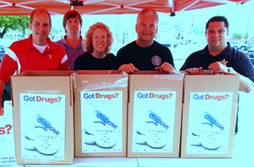 Shown with boxes of medications collected at the drug take-back day are, from left, Walgreens Store Manager Charles Mengel, employee Jimmy Woringen, Capt. Pat Childress,, Sheeriff James Pohlmann and Maj. Chad Clark.