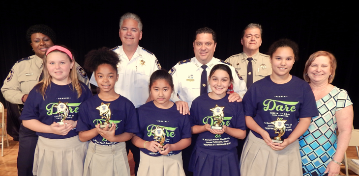Winners of the D.A.R.E. essay contest at Lacoste were, from left, Jenna LaBure, Kalia Calice, Mikylla Maghirang, Madison Silva and Jasmine Reese. At right is Principal Stacie Alfonso. In the back row, from left, are D.A.R.E. program coordinator Lt. Lisa Jackson, Sheriff James Pohlmann, Maj. Chad Clark and D.A.R.E. instructor Sgt. Darrin Miller.