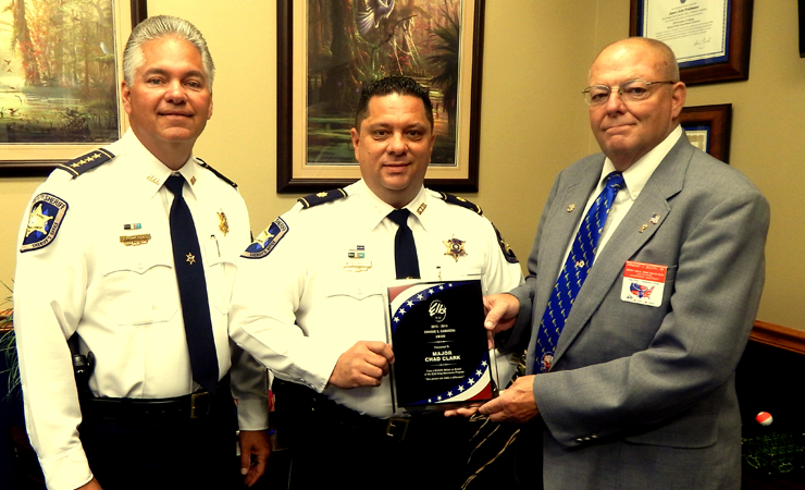 "Maj. Chad Clark receives the statewide Enrique  ""Kiki"" Camarena Award for drug-fighting from, at right, Armand Buuck of the Benevolent and Protective Order of Elks. At left is Sheriff James Pohlmann."