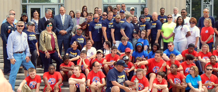 Competitors from St. Bernard in the Special Olympics Summer Games, along with sheriff's deputies, firefighters and state Wildlife agents and parish officials before the Law Enforcement Torch Run for Special Olympics began on Friday.