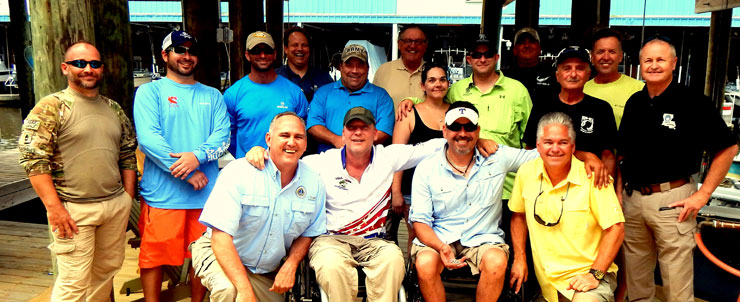 Military veterans, parish officials and sponsors of the event at a seafood lunch for the vets in St. Bernard Parish.