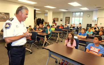 """Sheriff James Pohlmann tells the class they will """"some awesome things to do."""""""