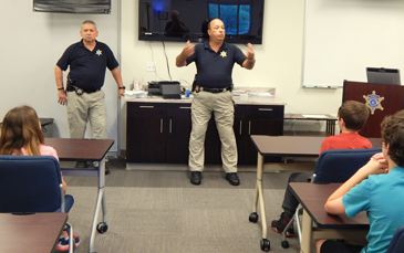 Capt. Charles Borchers, right, speaks to the Junior Deputy academy class and next to him is Dep. Sheriff Eric Eilers.