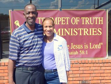 Pastor Robert Collins and wife, Florence, in front of their Trumpet of Truth Ministry at 7415 West St. Bernard Highway, Arabi.